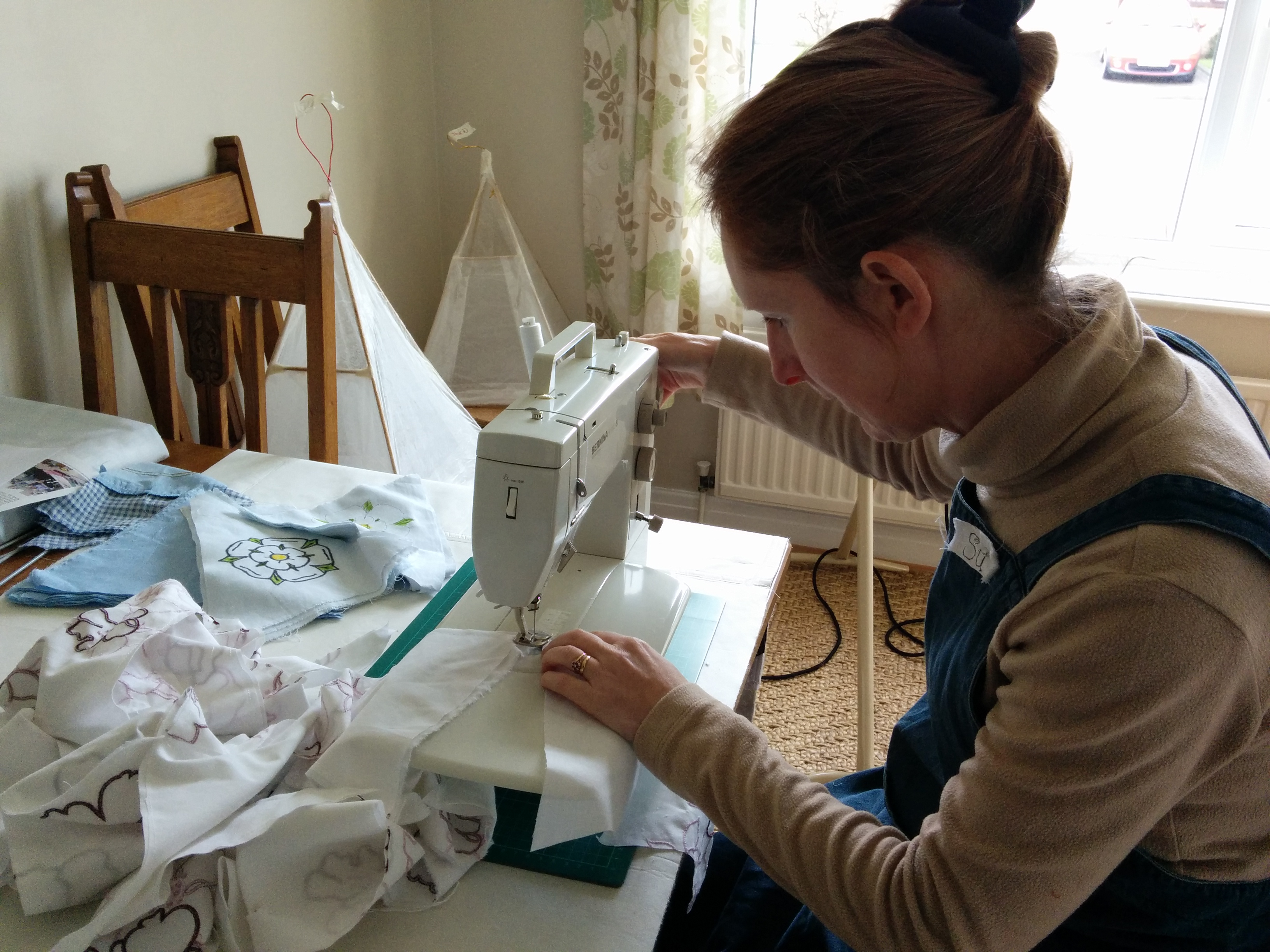 Image of person using a sewing machine