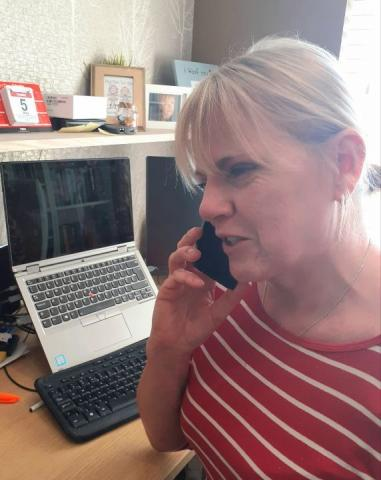 Customer Services Adviser on telephone