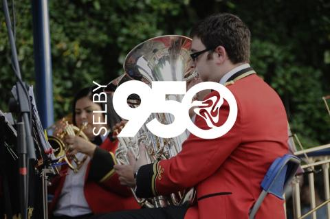 Selby950 project logo with a brass band background