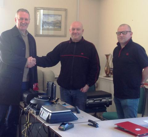 (R-L) - Cllr Tim Grogan with Chris Bolton and Iain Cliff, from the Post Office.