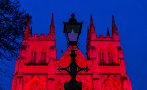 Selby Abbey illuminated red