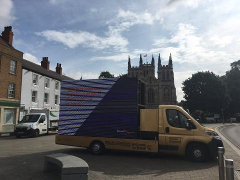image of a Crime stoppers van in front of the Selby Abbey