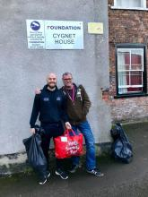 Image of a Wellbeing officer from Selby Leisure Centre collecting the donated coats