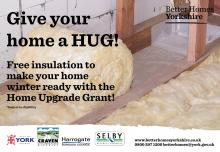 Loft insulation being rolled out in an attic