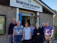 Councillor Chris Pearson and members of the Burton Salmon Village Hall Trust stood outside the village hall