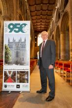 Councillor Chris Pearson with a Selby950 banner at the Selby Abbey