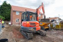 Image of a digger on a building site