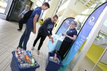Drax group handing out reusable water bottles at Selby College