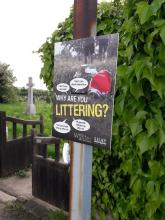Anti litter poster in Kellington. Poster shows a discarded cola can and excuses for littering.
